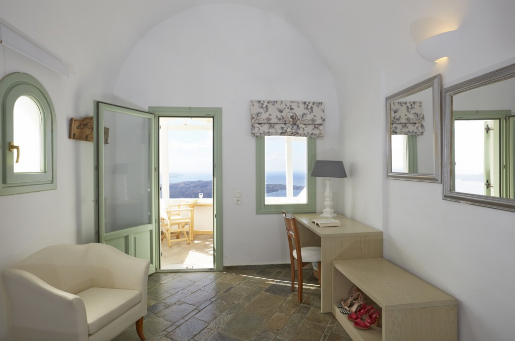The indoors of a caldera view suite of Ira Hotel & Spa in Santorini.