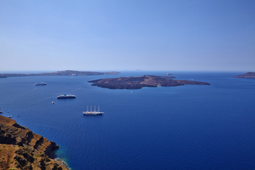 It could be you in this boat sailing around Santorini!